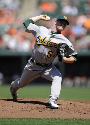 Photo - Oakland Athletics starting pitcher Sonny Gray delivers against the Baltimore Orioles during the first inning of a baseball game on Sunday, Aug. 25, 2013, in Baltimore. (AP Photo/Nick Wass)