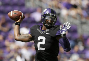 Photo - TCU quarterback Trevone Boykin (2) passes against Kansas in the first half of an NCAA college football game, Saturday, Oct. 12, 2013, in Fort Worth, Texas. (AP Photo/Tony Gutierrez)