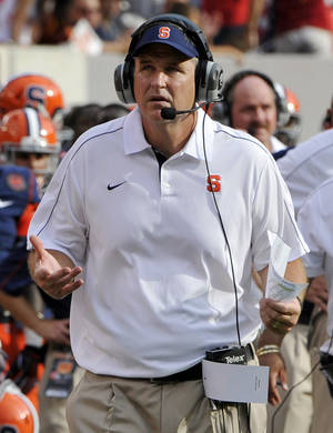 Photo -   Syracuse coach Doug Morrone reacts during the second quarter of an NCAA college football game against Southern California on Saturday, Sept. 8, 2012, in East Rutherford, N.J. USC defeated Syracuse 42-29. (AP Photo/Bill Kostroun)