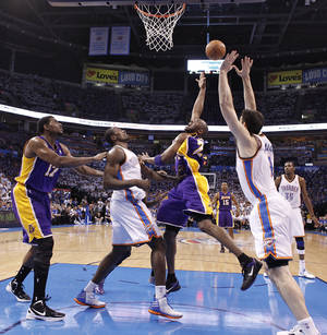 Photo - Los Angeles' Kobe Bryant puts up a shot over Oklahoma City's Serge Ibaka and Nick Collison during Game 2 in the second round of the NBA playoffs between the Oklahoma City Thunder and the L.A. Lakers at Chesapeake Energy Arena on Wednesday,  May 16, 2012,in Oklahoma City, Oklahoma. Photo by Chris Landsberger, The Oklahoman