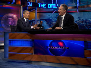 "Photo -   President Barack Obama talks with Jon Stewart during a taping of his appearance on ""The Daily Show with John Stewart"", Thursday, Oct. 18, 2012, in New York. (AP Photo/Carolyn Kaster)"
