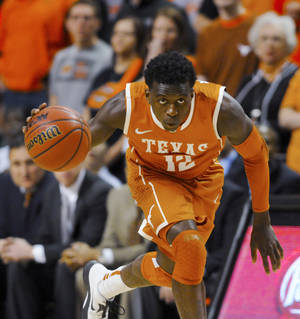 Photo - Texas guard Myck Kabongo looks up the court after stealing the ball from Oklahoma State during the first half of an NCAA basketball game in Stillwater, Okla., Saturday, March 2, 2013. Oklahoma State won 78-65. (AP Photo/Brody Schmidt)