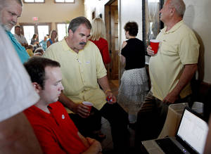 Photo - Oklahoma Senate District 41 candidate Paul Blair, R-Edmond, watches primary results Tuesday in Edmond. Photo by Bryan Terry, The Oklahoman