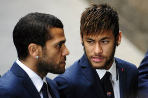 Photo - FC Barcelona's Neymar, from Brazil, right, and Daniel Alves, from Brazil, arrive for a religious ceremony at Barcelona Cathedral for late former FC Barcelona's coach Tito Vilanova in Barcelona, Spain, Monday, April 28, 2014. FC Barcelona announced on their web page Friday April 25, 2014, that Vilanova had died Friday following a long battle with throat cancer. He was 45. (AP Photo/Manu Fernandez)