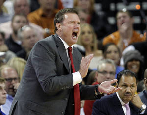 Photo - Kansas coach Bill Self talks to his players during the second half of an NCAA college basketball game against Texas, Saturday, Jan. 21, 2012, in Austin, Texas. Kansas won 69-66.  (AP Photo/Eric Gay) ORG XMIT: TXEG108