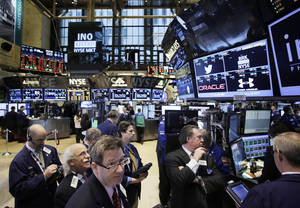 Photo - FILE - In this  Wednesday, Feb. 12, 2014, file photo, traders monitor stock prices at the New York Stock Exchange. Stocks were mostly higher in midday trading Tuesday, Feb. 18, 2014, as investors returned from a long holiday weekend.  (AP Photo/Mark Lennihan)