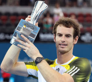 photo - Andy Murray of Britain holds the winner's trophy after winning the men's final match against Grigor Dimitrov of Bulgaria 7-6, 6-4 during the Brisbane International tennis tournament in Brisbane, Australia, Sunday, Jan 6, 2013.  (AP Photo/Tertius Pickard).