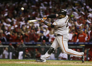 Photo -   San Francisco Giants' Pablo Sandoval (48) flies out during the ninth inning of Game 3 of baseball's National League championship series against the St. Louis Cardinals, Wednesday, Oct. 17, 2012, in St. Louis. The Cardinals won 3-1. (AP Photo/Jeff Roberson)
