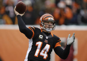 Photo - Cincinnati Bengals quarterback Andy Dalton passes against the Indianapolis Colts in the first half of an NFL football game, Sunday, Dec. 8, 2013, in Cincinnati.  Cincinnati won 42-28. (AP Photo/Al Behrman)