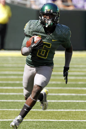 Photo -   Oregon running back De'Anthony Thomas rushes during the first half of their NCAA college football game against Tennessee Tech in Eugene, Ore., Saturday, Sept. 15, 2012. Oregon won 63-14. (AP Photo/Don Ryan)