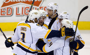 Photo - Nashville Predators' Seth Jones, from left to right, Nick Spaling, Matt Cullen, Craig Smith and Ryan Ellis celebrate Jones' winning goal against the Vancouver Canucks during third period NHL hockey action in Vancouver, British Columbia on Thursday Jan. 23, 2014. (AP Photo/The Canadian Press, Darryl Dyck)