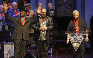 "Photo -   FILE - In this Oct. 28, 2008 file photo, Booker T. Jones, left, Steve Cropper, center, and Donald ""Duck"" Dunn, right, of the group Booker T. & the MGs, acknowledge the applause as they are inducted into the Musicians Hall of Fame in Nashville, Tenn. Bass player and songwriter Dunn died in Tokyo, Sunday May 13, 2012. He was 70. (AP Photo/Mark Humphrey, File)"
