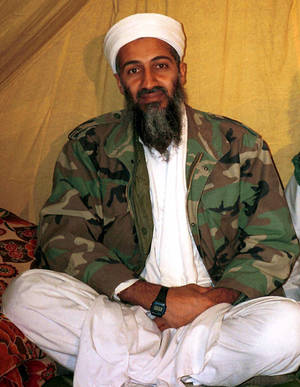 Photo -   This undated file photo shows al Qaida leader Osama bin Laden, in Afghanistan. A firsthand account of the Navy SEAL raid that killed Osama bin Laden contradicts previous accounts by administration officials, raising questions as to whether the terror mastermind presented a clear threat when SEALs first fired upon him. (AP Photo)