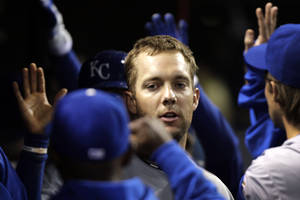 Photo -   Kansas City Royals left fielder Alex Gordon celebrates in the dugout after hitting a three-run home run against the Cleveland Indians in the ninth inning of a baseball game in Cleveland, Wednesday, April 25, 2012. (AP Photo/Amy Sancetta)