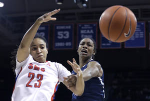 Photo - Connecticut guard Brianna Banks (13) and SMU guard Keena Mays (23) battle for control of the ball during the first half of an NCAA college basketball game Tuesday, Feb. 25, 2014, in Dallas. (AP Photo/LM Otero)