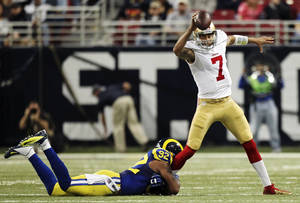 photo - St. Louis Rams defensive end Eugene Sims (92) sacks San Francisco 49ers quarterback Colin Kaepernick (7) during the second quarter of their NFL football game, Sunday, Dec. 2, 2012, in St. Louis. The Rams won 16-13 in overtime. (AP Photo/St. Louis Post-Dispatch, Chris Lee)  EDWARDSVILLE INTELLIGENCER OUT; THE ALTON TELEGRAPH OUT