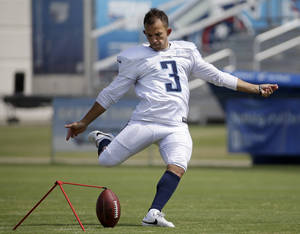 Photo - FILE -- In this July 31, 2014 file photo, Tennessee Titans kicker Maikon Bonani practices during NFL football training camp Thursday, July 31, 2014, in Nashville, Tenn. Bonani fell 35 feet from a theme park gondola in an accident that left him with broken vertebra in his back and cost him a season at South Florida. Now the native of Brazil is in Tennessee for a second training camp and competing to be the Titans' new kicker. (AP Photo/Mark Humphrey, File)