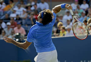 Photo - Roger Federer, of Switzerland, serves to Grega Zemlja, of Slovenia, during the first round of the 2013 U.S. Open tennis tournament Tuesday, Aug. 27, 2013, in New York. (AP Photo/Mike Groll)