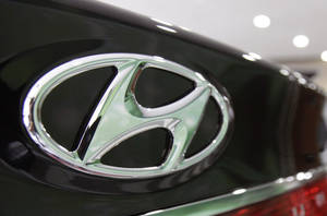 Photo -  The logo of Hyundai Motor Co. is seen on its car at the company's showroom in Seoul, South Korea.  AP Photo  <strong>Ahn Young-joon -  AP </strong>
