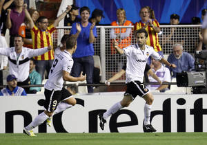 Photo -   Valencia's Jonas from Brazil, right, and Roberto Soldado, left, celebrate after scoring against Lille during their Champions League Group L soccer match at the Mestalla stadium in Valencia, Spain, Tuesday, Oct. 2, 2012. (AP Photo/Alberto Saiz)