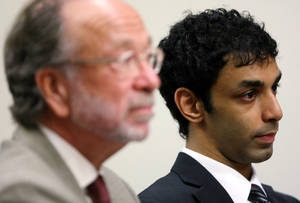 Photo -   Former Rutgers student Dharun Ravi, right, Tyler Clementi's former roommate, and his attorney Steven Altman listen as Judge Glenn Beman, not seen, speaks at the Middlesex County Court in New Brunswick, during a motion hearing Friday, Sept. 9, 2011 in New Brunswick, N.J. Berman on Friday refused to dismiss hate crime, invasion of privacy and other charges against Ravi. He also says prosecutors must give defense lawyers the name of the man who was allegedly seen in a webcam video having an intimate encounter with Rutgers student Tyler Clementi. Clementi killed himself by jumping from the George Washington Bridge soon after the incident last September. (AP Photo/Mark R. Sullivan, Pool)