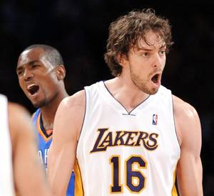 Photo - Lakers forward Pau Gasol, right, twice blocked Jeff Green shots in the first quarter. AP Photo