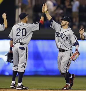 Photo - Washington Nationals' Ian Desmond (20) and Bryce Harper celebrate after the Nationals' baseball game against the Kansas City Royals on Saturday, Aug. 24, 2013, in Kansas City, Mo. The Nationals won 7-2. (AP Photo/Charlie Riedel)