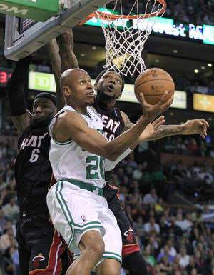 Photo -   File - In this June 1, 2012, file photo, Boston Celtics guard Ray Allen (20) drives past Miami Heat forward LeBron James (6) and forward Udonis Haslem during the second quarter of Game 3 in the NBA basketball playoffs Eastern Conference finals in Boston. Allen told the Heat on Friday night, July 6, 2012, that he has decided to leave the Celtics and join up with the reigning NBA champions. (AP Photo/Elise Amendola, File)