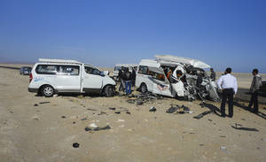 photo - The aftermath of a two-vehicle accident, which left at least four Germans and several Egyptians dead and others injured, is seen on the road between Hurghada and Safaga on the Red Sea coast of Egypt, Sunday, Dec. 2, 2012. Egypt's roads are among the most dangerous in the world. Car accidents are common due to lax enforcement of driving laws and poorly paved roads, leading to thousands of deaths each year. (AP Photo)