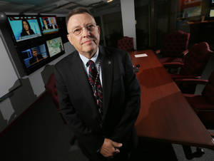 photo - David Stenhouse, director of the Oklahoma Information Fusion Center, stands inside the Oklahoma State Bureau of Investigation at 6600 N Harvey, Oklahoma City. Photo by Nate Billings, The Oklahoman