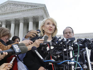 "Photo -   FILE - In this Wednesday, April 25, 2012 file photo, Arizona Gov. Jan Brewer speaks to reporters after the Supreme Court questioned Arizona's ""show me your papers"" immigration law in front of the Supreme Court in Washington. On Thursday, Sept. 6, 2012, Brewer's office said the most contentious section of Arizona's immigration law is expected to go into effect shortly. A spokesman says Brewer is pleased with a federal judge's decision on Wednesday, Sept. 5, 2012 to allow enforcement of the law. It enables officers, while enforcing other laws, to question the immigration status of those they suspect are in the country illegally. The National Immigration Law Center says it's considering ""legal options"" after the ruling. (AP Photo/Charles Dharapak)"