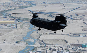 Photo - This handout photo provided by the US Army, taken Oct. 26, 2013, shows a 10th Combat Aviation Brigade CH-47 Chinook helicopter, operated by members of the Texas and Oklahoma National Guard, flying a personnel and equipment movement mission over Kabul, Afghanistan. To outfit Afghanistan's security forces with new helicopters, the Pentagon bypassed U.S. companies and turned instead to Moscow for dozens of Russian Mi-17 rotorcraft at a cost of more than $1 billion. Senior Pentagon officials assured skeptical members of Congress they'd made the right call, pointing repeatedly to a top-secret 2010 study they said named the Mi-17 as the superior choice.  (AP Photo/Capt. Peter Smedberg, USCArmy)