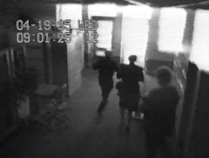 Photo - A Southwestern Bell security camera recorded people fleeing the building in the seconds after the Oklahoma City bombing. The time on the recording is slightly behind the established time of the explosion -- 9:02 a.m. April 19, 1995.