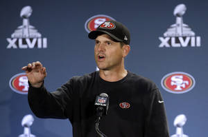 Photo - San Francisco 49ers head coach Jim Harbaugh talks with reporters during a news conference on Monday, Jan. 28, 2013, in New Orleans. The 49ers are scheduled to play the Baltimore Ravens in the NFL Super Bowl XLVII football game on Feb. 3. (AP Photo/Mark Humphrey)