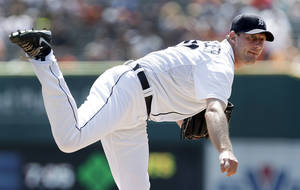 Photo - FILE - In this Aug. 29, 2013, file photo, Detroit Tigers' Max Scherzer watches a pitch to an Oakland Athletics batter in the first inning of a baseball game in Detroit. Scherzer won the American League Cy Young Award on Wednesday, Nov. 13, 2013. (AP Photo/Paul Sancya, File)