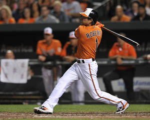 Photo - FILe - In this Aug. 17, 2013 file photo, Baltimore Orioles' Brian Roberts follows through on a two-run double against the Colorado Rockies in the third inning of a baseball game in Baltimore. A person familiar with the negotiations says second baseman Brian Roberts and the New York Yankees have agreed to a $2 million, one-year contract. The person spoke to The Associated Press on condition of anonymity Tuesday, Dec. 17, 2013,  because the agreement, which includes performance bonuses, was subject to a physical. (AP Photo/Gail Burton, File)