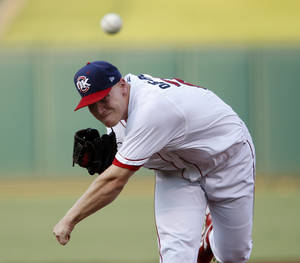 photo - Brett Oberholtzer pitches against the Sacramento River Cats during a baseball game at  Chickasaw Bricktown Ballpark in Oklahoma City, Friday, August 10, 2012. Photo by Bryan Terry, The Oklahoman