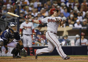 Photo - Arizona Diamondbacks' Miguel Montero follows through on a two-run home run against the San Diego Padres during the sixth inning of a baseball game Saturday, June 28, 2014, in San Diego. (AP Photo/Lenny Ignelzi)