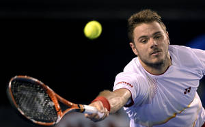 Photo - Stanislas Wawrinka of Switzerland makes a forehand return to Tomas Berdych of the Czech Republic during their semifinal at the Australian Open tennis championship in Melbourne, Australia, Thursday, Jan. 23, 2014.(AP Photo/Andrew Brownbill)