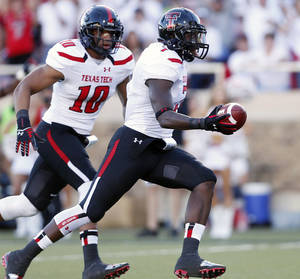 Photo - Texas Tech's Will Smith (7) scores a touchdown after a Texas State fumble with Pete Robertson (10) during their NCAA college football game in Lubbock, Texas, Saturday, Sept. 21, 2013. (AP Photo/Lubbock Avalanche-Journal, Stephen Spillman) ALL LOCAL TV OUT