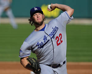 Photo - Los Angeles Dodgers starting pitcher Clayton Kershaw throws during the first inning of Game 2 of the National League baseball championship series against the St. Louis Cardinals Saturday, Oct. 12, 2013, in St. Louis. (AP Photo/Jeff Curry, Pool)