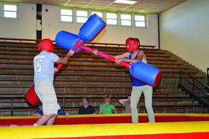 Photo - Two Putnam City students joust with foam during a past event to behefit cancer research. Photo provided <strong></strong>