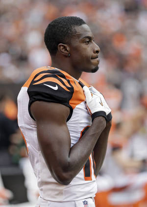 Photo - Cincinnati Bengals wide receiver A.J. Green watches from the sidelines late in the fourth quarter of a 17-6 loss to the Cleveland Browns in an NFL football game Sunday, Sept. 29, 2013, in Cleveland. (AP Photo/Tony Dejak)