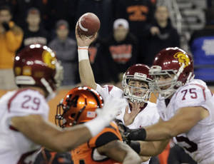 Photo - Southern California quarterback Cody Kessler passes during the first half of an NCAA college football game against Oregon State in Corvallis, Ore., Friday, Nov. 1, 2013. (AP Photo/Don Ryan)
