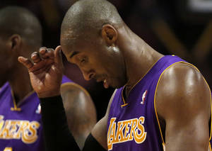 photo - Los Angeles Lakers shooting guard Kobe Bryant walks off the court during a break in the action during the second half of an NBA basketball game against the Chicago Bulls Monday, Jan. 21, 2013, in Chicago. The Bulls won 95-83. (AP Photo/Charles Rex Arbogast)