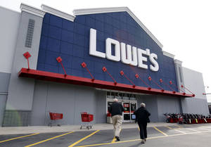 Photo -   FILE -- In a Nov. 14, 2011 file photo, customers walk toward the Lowe's store in Saugus, Mass. Lowe's Cos.'reported Monday May 21, 2012, first-quarter profit climbed 14 percent, as warmer weather helped boost sales. (AP Photo/Michael Dwyer/file)
