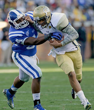 Photo -   Georgia Tech quarterback Tevin Washington, right, runs the ball against the defense of Duke's C.J. France in the first quarter of an NCAA college football game on Saturday, Nov. 17, 2012, in Atlanta. (AP Photo/David Goldman)