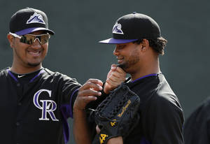 Photo - Colorado Rockies starting pitcher Jhoulys Chacin, left, pulls on the beard of invitee pitcher Manuel Corpas during baseball spring training Friday, Feb. 21, 2014, in Scottsdale, Ariz. (AP Photo/Gregory Bull)