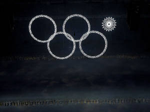 Photo - One of the Olympic rings fails to open during the opening ceremony of the 2014 Winter Olympics in Sochi, Russia, Friday, Feb. 7, 2014. (AP Photo/David J. Phillip )