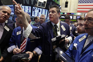 Photo - Trader William McInerney, center, works  on the floor of the New York Stock Exchange Friday, April 4, 2014.  Stocks are edging mostly higher in early trading Friday after the government reported that U.S. employers added to their payrolls last month. (AP Photo/Richard Drew)